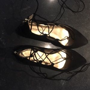 Never worn size 8.5 BCBG black suede lace up flats